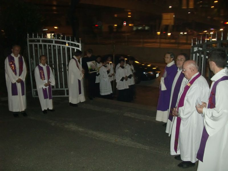 Priests outside church