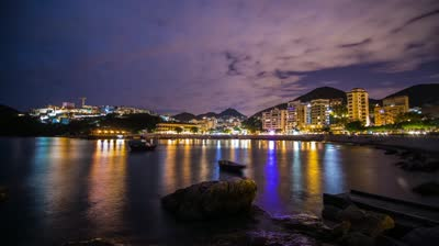 Stock-footage-time-lapse-of-cloudy-night-at-stanley-bay-people-walking-in-and-out-with-flashlight-in-hong-kong