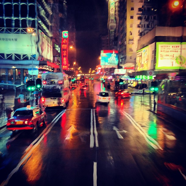 Through-a-rain-soaked-windshield-mongkok-roads-on-a-rainy-night.-hongkong-hk-hkig